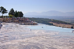 PAMUKKALE, TURKEY - September 13, 2015: Tourists regard the travertines with pools and terraces at Pamukkale. Pamukkale is include Royalty Free Stock Images