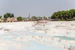 Pamukkale, Turkey. Tourists visiting the beautiful travertine terraces Stock Image