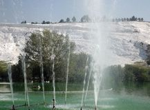 Pamukkale in Turkeyy. Pamukkale in TurkeynThe famous travertine and a thermal pool in Pamukkale, Turkeyn Stock Photos