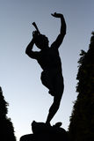 Pan. The silhouette of Pan in the Jardin of the luxembourg-Paris Royalty Free Stock Image