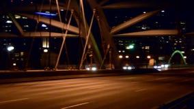 Pan across bridge into the city stock footage