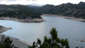Pan across a mountain lake stock video footage