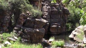 Arizona, Slide Rock, A pan across tall rock formations that surround Oak Creek