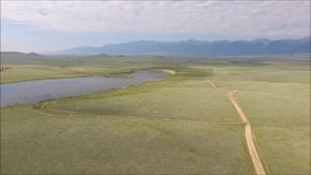 Pan along dirt road at Deweese Reservoir, Colorada stock video footage