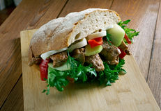 Pan-bagnat. Sandwich that is a specialty of the region of Nice, France Royalty Free Stock Image