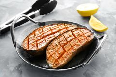 Pan with baked sweet potato. On table royalty free stock photo