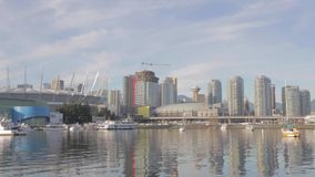 Pan BC place downtown Vancouver - sunshine. VANCOUVER,CANADA - CIRCA December 2014 :Pan BC place downtown Vancouver - sunshine stock video footage