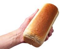 Pan blanco en su mano Imagen de archivo libre de regalías