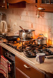 Pan boiling on burning gas stove on country style kitchen Stock Photos