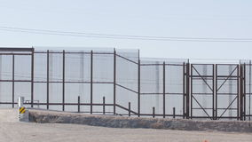 Pan of Border Fence. Beautiful pan of the fence on the border of US and Mexico stock video footage