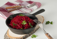 Pan with braised beetroot and parsley Royalty Free Stock Image
