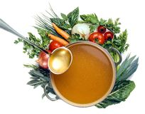 Pan of broth and vegetables isolated stock photos