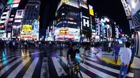 Pan of Busy Shinjuku Entertainment / Shopping District at Night - Tokyo Japan stock video footage