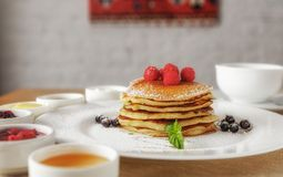 Pan cakes. With honey and berries stock photography