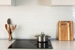 The pan is on a ceramic cooking plate in the new modern kitchen royalty free stock photo