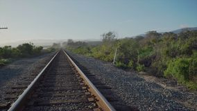 Pan of coast train track near Point Conception State Marine Reserve stock footage