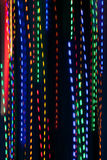 Pan Of Colorful Holiday Lights Creates Electric Rain Pattern Royalty Free Stock Image
