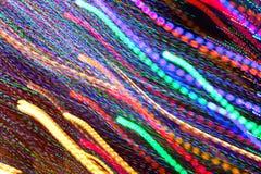 Pan Of Colorful Holiday Lights sieht wie Samenzellen-Schwimmen aus Stockbilder