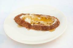 Pan con la comida de la miel fotografía de archivo