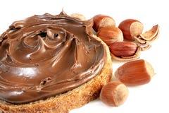 Pan con la extensión de la avellana del chocolate dulce Foto de archivo