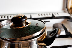 Pan on cooker Stock Images
