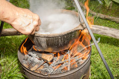 Pan. Cooking in metal pan on campfire Stock Image