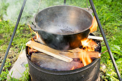 Pan. Cooking in a metal pan in a campfire Royalty Free Stock Photography
