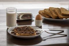 Pan cortado con leche y el huevo en tenedor Imágenes de archivo libres de regalías