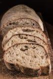 Pan cortado de Panini en un tablero de madera en luz de la ventana imagen de archivo libre de regalías