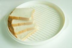 Pan cuatro en la placa Imagen de archivo libre de regalías