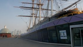 Pan from Cutty Sark to Canary Wharf stock footage