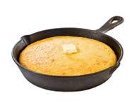 Pan de maíz en skillet del hierro Imagenes de archivo