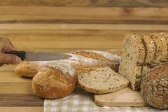 Pan del grano en fondo de madera Imágenes de archivo libres de regalías