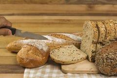Pan del grano en fondo de madera Imagen de archivo