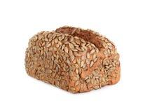 Pan del trigo integral aislado en el fondo blanco fotografía de archivo