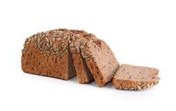 Pan del trigo integral aislado en el fondo blanco fotografía de archivo libre de regalías