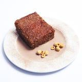 Pan di Spagna del cioccolato e della nocciola Immagini Stock Libere da Diritti