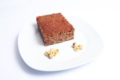 Pan di Spagna e nocciole del cioccolato Fine in su Immagine Stock Libera da Diritti