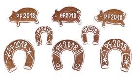 Pan di zenzero del nuovo anno per buona fortuna isolati su fondo bianco Immagini Stock