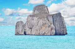 Pan di Zucchero isle. Under a cloudy sky Royalty Free Stock Photos