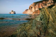 Pan di Zucchero, near Masua, Sardinia (Italy). Pan di Zucchero is the Rock merging from the sea along South West coast of Sardinia, nearby the city of Masua and Stock Photos