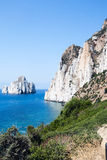 Pan di Zucchero rocks in the sea and Masua's sea stack (Nedida), Royalty Free Stock Photo
