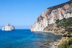 Pan di Zucchero rocks in the sea and Masua's sea stack (Nedida), Stock Image