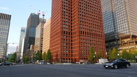 Pan Down of Building to Traffic in Central Tokyo Japan stock video
