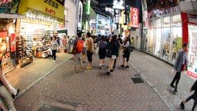 Pan Down - Busy Shinjuku Entertainment / Shopping District at Night - Tokyo Japan stock footage