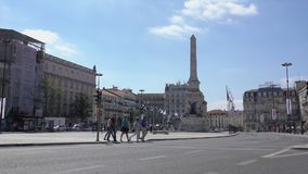 Pan down of Restauradores Square. Typical scene for visitors to Restauradores Square in Lisbon Portugal stock video