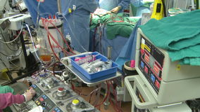 Pan down to heart lung bypass machine. Scene from a typical hospital stock video