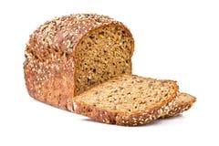 Pan entero del grano en el fondo blanco Imagen de archivo