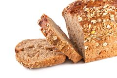 Pan entero del grano y de la zanahoria en blanco Foto de archivo libre de regalías