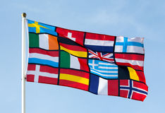 Pan European flag against the blue sky Royalty Free Stock Photo
